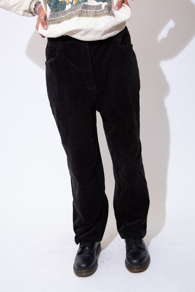 Black, soft corduroy pants in a straight leg fit with belt loops, front pockets and back pockets.