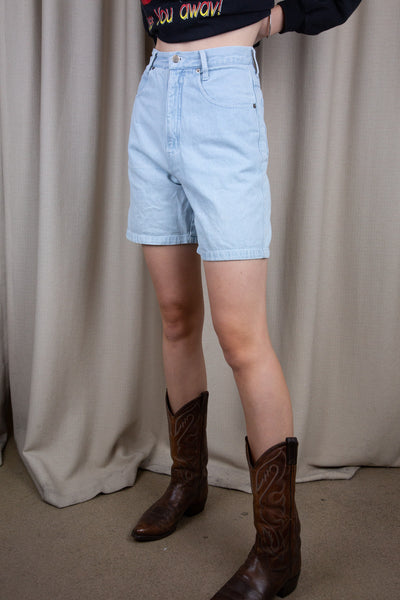 Light wash denim shorts in midi-length fit, these high waisted shorts have white stitching and Ivy branding on the back waistline.