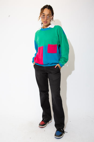 model wears a colourblocked vintage sweater