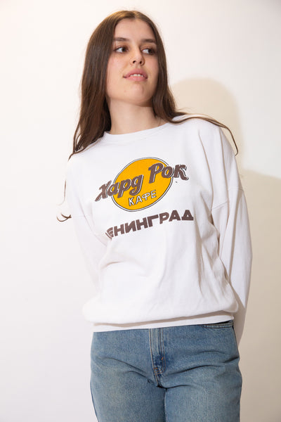White in colour, this jumper has a 'Hard Rock Cafe' style logo on the front. On the back is a large print of some serious looking guys and the symbol for communism and socialism (yeet) and the Russian flag.