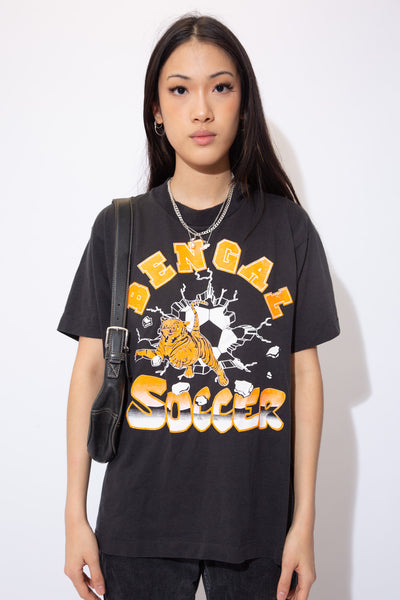 the model wears a faded black tee with a bengal soccer spell out on the front