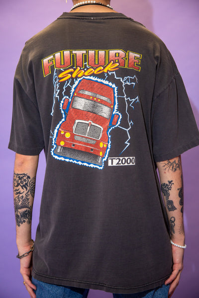 Faded black single stitch tee with 'Kenworth Chillicothe' printed on the left chest pocket. On the back, 'Future Shock' is printed across the top with a lightening truck print below.