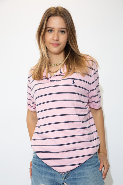 Light pink polo style tee with horizontal navy blue lines and a navy blue embroidered Ralph Lauren logo on the left chest.