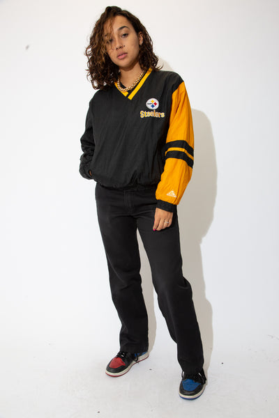 the model wears a yellow and black steelers sweater