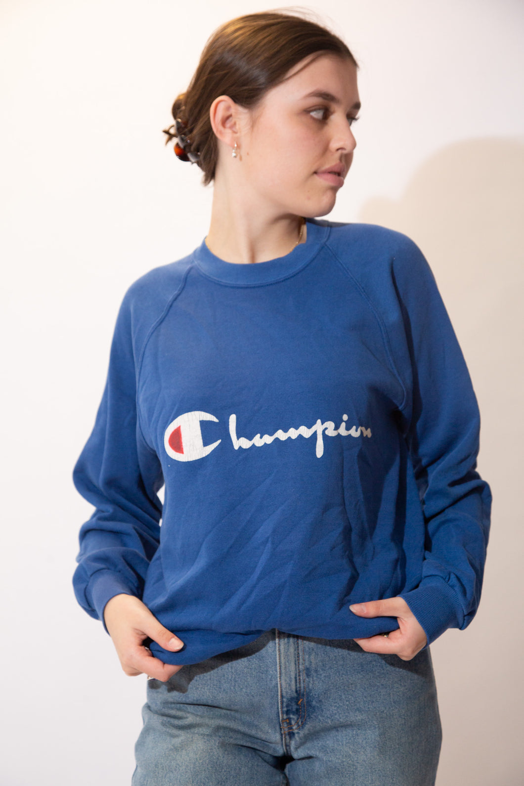 Blue in colour, this jumper has a white 'Champion' spell-out across the front with the brand's logo as the 'C'.