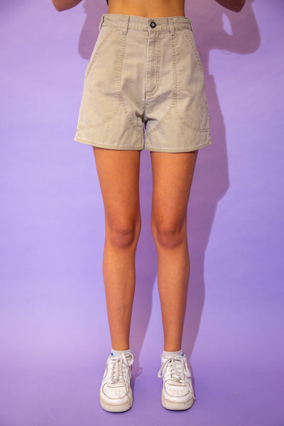the model wears a khaki pair of patagonia shorts
