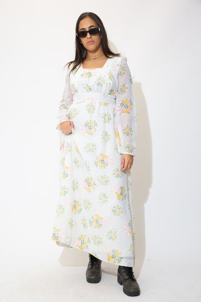 the model wears a white floral maxi dress