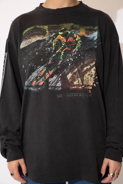 the model wears a faded black long sleeve with a ski graphic
