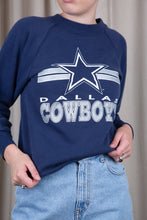 Load image into Gallery viewer, Navy blue in colour, this jumper has a white and grey 'Dallas Cowboy' spell-out across the front with the logo above.