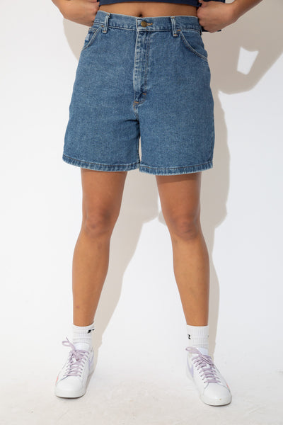 Soft mid-wash denim shorts in a high waisted fit with light brown stitching and Wrangler branding on the button and pocket. Pair with a cropped Hard Rock Cafe tee and Jordans for a sick fit!