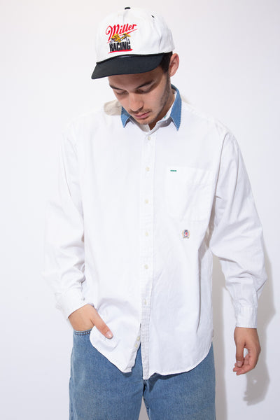 White button-up with contrast denim collar and Tommy Hilfiger branding under the left chest pocket.