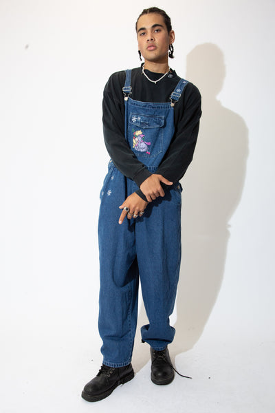 Dark-wash dungarees in a straight leg fit with light blue stitching, button-up sides and an embroidered Pooh Bear and Eeyore appliqué on the front chest pocket with embroidered snowflakes on the right leg, chest pocket, back pocket, buttons and straps.