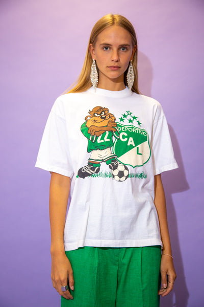 the model wears a white tee with a taz graphic