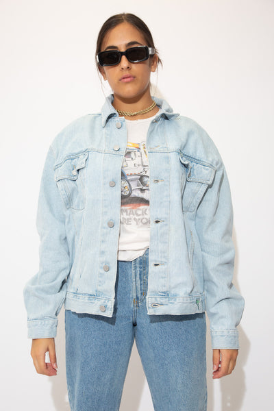 the model wears a light wash blue denim jacket