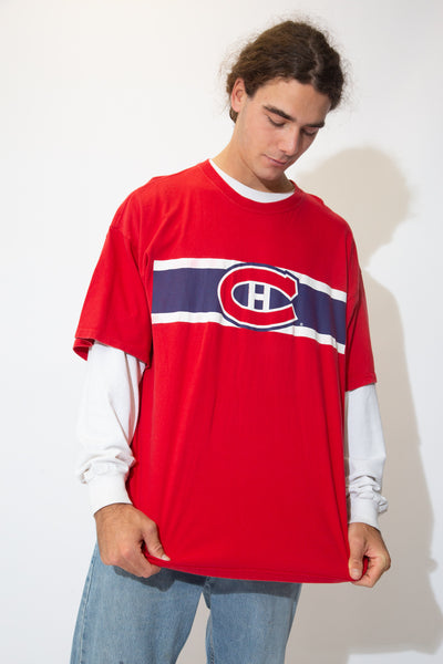 Oversized red tee with a blue and white striped detail on the front and a 'C' and 'H' printed in the middle of the tee.