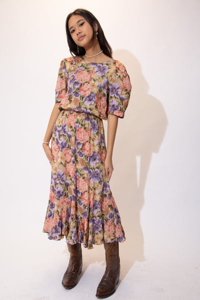the model wears a floral midi dress