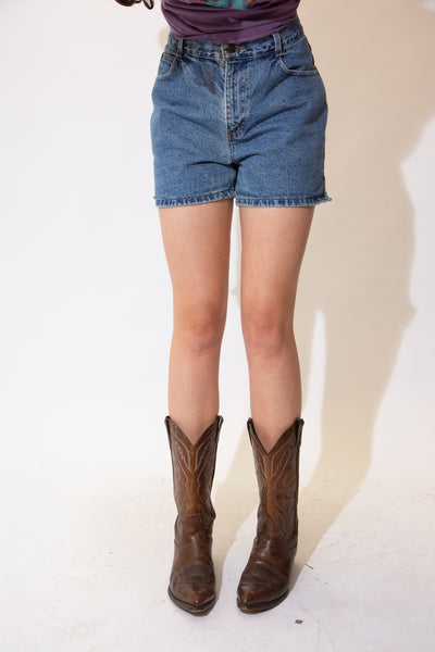 Mid-wash blue denim shorts in a high-waisted fit with brown stitching, v-cuts in the sides and Gitano branding on the button, domes and back waistline.