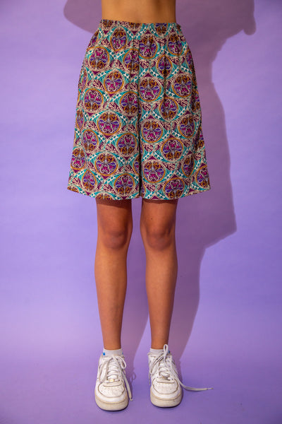 the model wears a pair of paisley cotton shorts