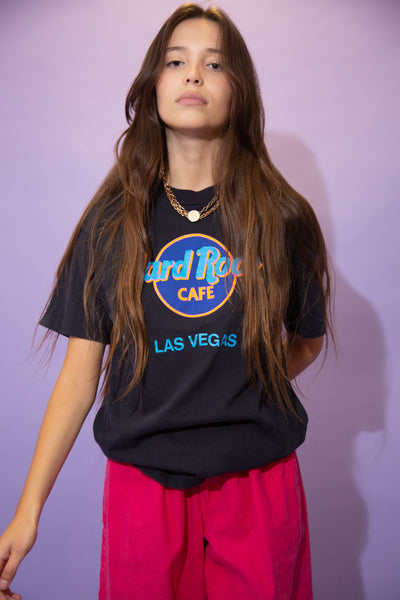 Black single stitch tee with a luminous coloured Hard Rock Cafe logo on the front. Repping Las Vegas below