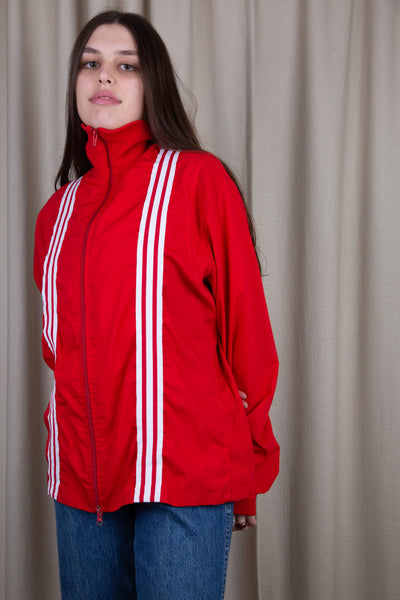 Red in colour, this jacket has a hard exterior, a full length zip, a fold over neckline and the signature three white stripes down the front. Throw over a white crop with baggy jeans and Airforce 1s for a sick fit!