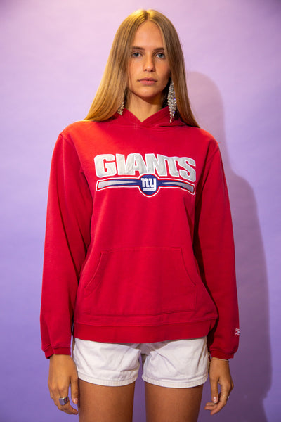 the model wears a black hoodie with a giants spell out on the front