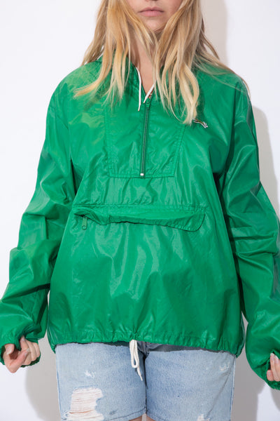Green anorak style pullover with a quarter zip, a kangaroo pouch style pocket, drawstrings and a fox logo embroidered on the left chest.
