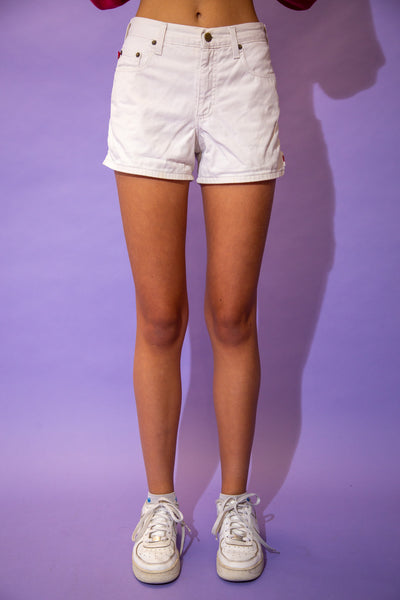 the model wears a pair of white mudd denim shorts