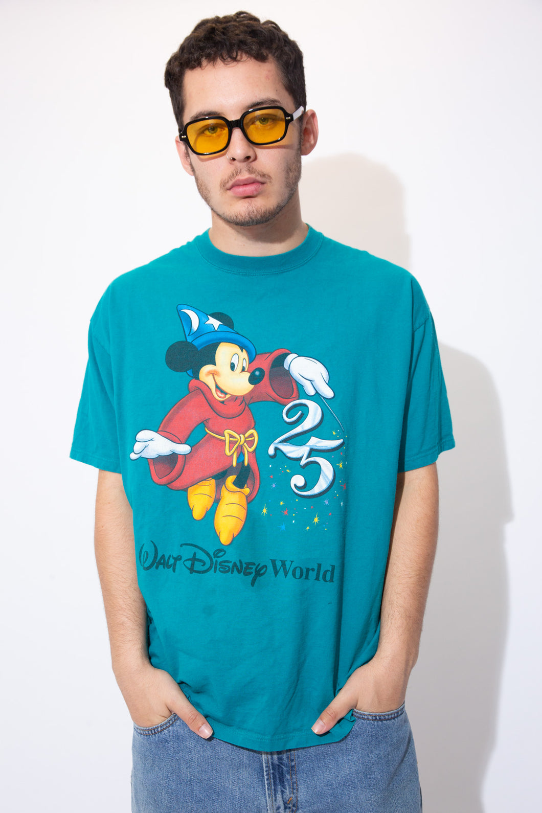 Turquoise tee with a large Mickey Mouse print on the front and Walt Disney World' printed below.