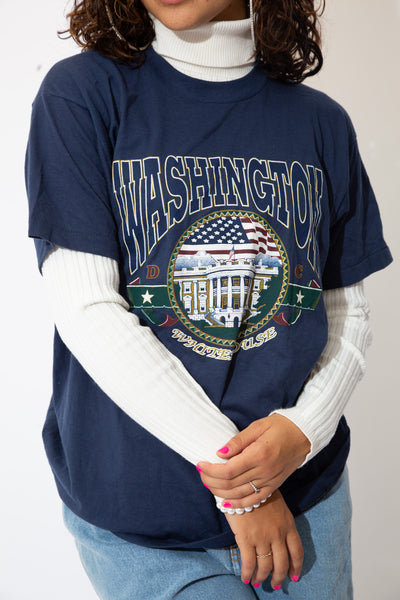 the model wears a navy tee with washington spell out