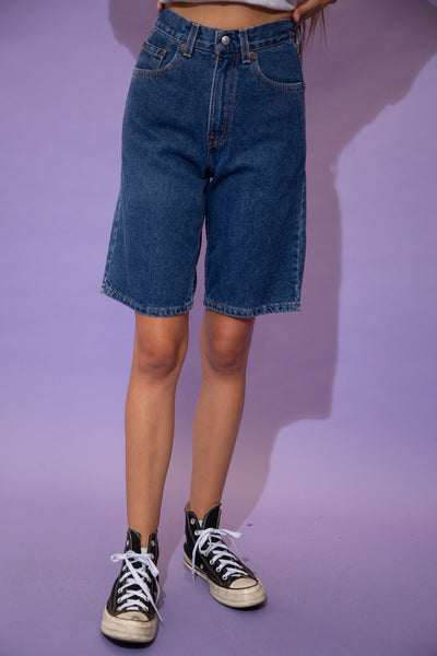 Dark wash denim shorts in a slim style and midi length fit with brown stitching and Levi's branding on the back waistline, back pocket, button and domes.