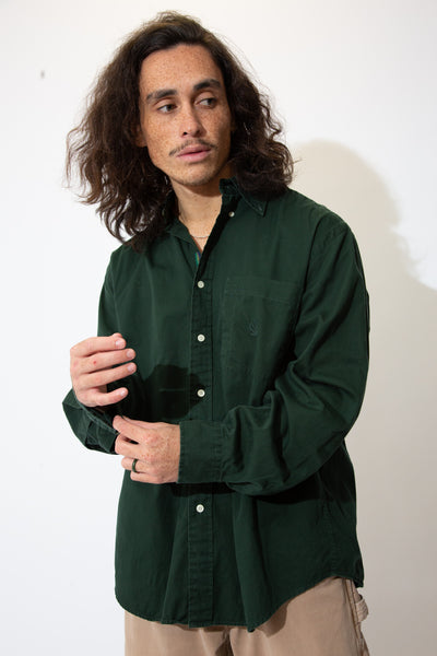 Dark green button-up with full-length white buttons and sick Nautica branding embroidered on the lil chest pocket.