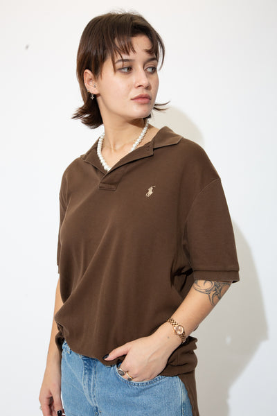 the model wears a chocolate brown polo