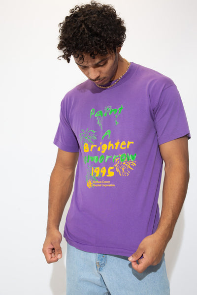 Purple single stitch tee with a green and yellow 'Paint A Brighter Tomorrow' spell-out across the front and dated 1995. Repping Durham County Hospital Corporation below