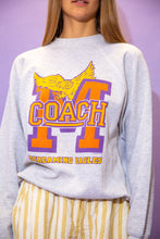 Load image into Gallery viewer, the model wears a grey sweater with a 'coach' graphic on the front