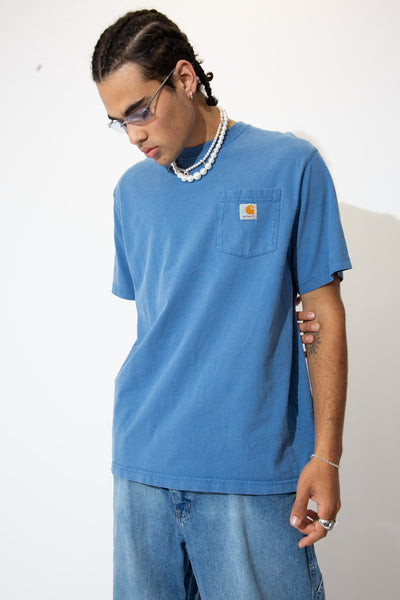 Cop some kick ass Carhartt now! Muted blue in colour with the classic oversized Carhartt tee and a pocket with a label patch on the left breast. Layer with a long-sleeve or under a bomber for a winter fit or rock it alone with a pair of vintage Calvin jeans.