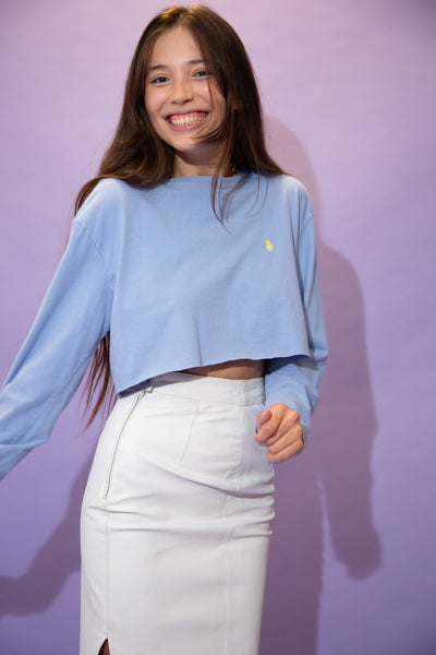 Blue in colour and soft in feel, this long sleeved tees is in a crew neck style with an embroidered yellow Ralph Lauren logo on the left chest.