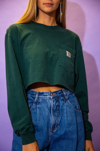 the model wears a green long sleeve carhartt crop