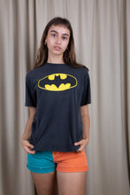 Load image into Gallery viewer, the model wears a faded black tee with a batman logo