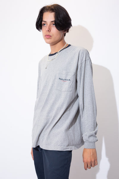 Grey long-sleeved tee with a navy blue rimmed neckline and Nautica branding on the left chest pocket.