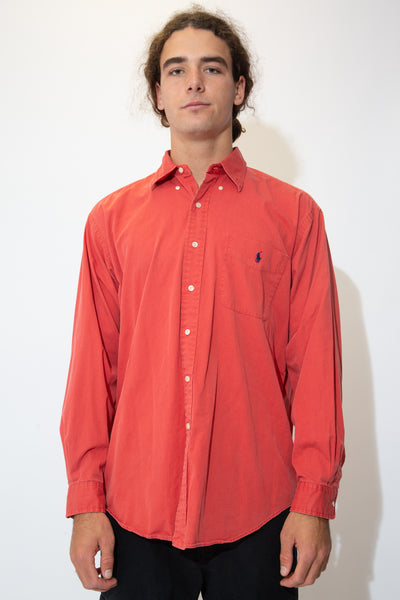 Red Ralph Lauren Button-Up with white buttons and a navy blue embroidered Ralph Lauren logo on the left chest pocket.