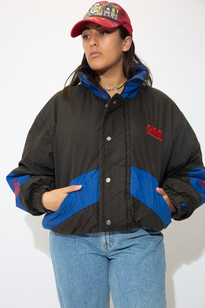 the model wears a black giants jacket