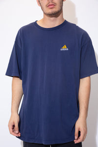 the model wears a navy blue adidas t shirt