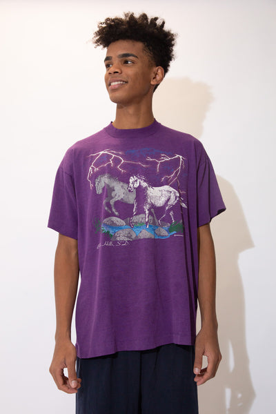 Purple tee with a colour print of horses, lightening and a stream on the front, this tee has some seriously immaculate vibes. Dated 1994