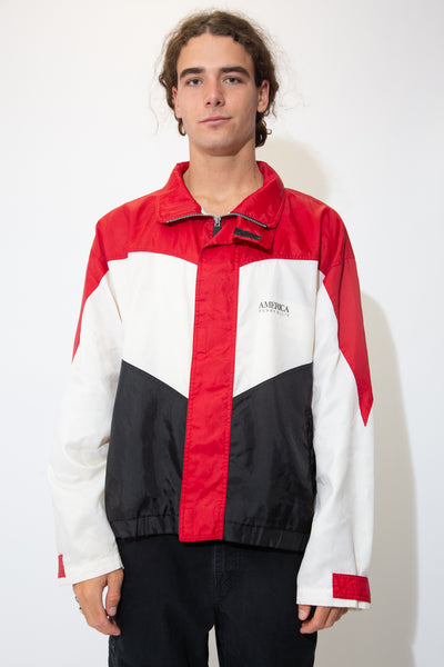 hamish wears a red, white and black perry ellis jacket