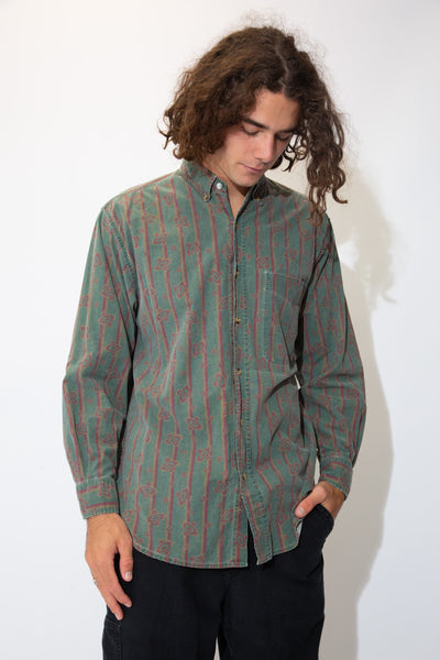 Dark green button-up with a maroon and brown striped abstract pattern across the shirt. With light brown buttons and a left chest pocket, pair with dark wash jeans and Jordans for a sick fit!