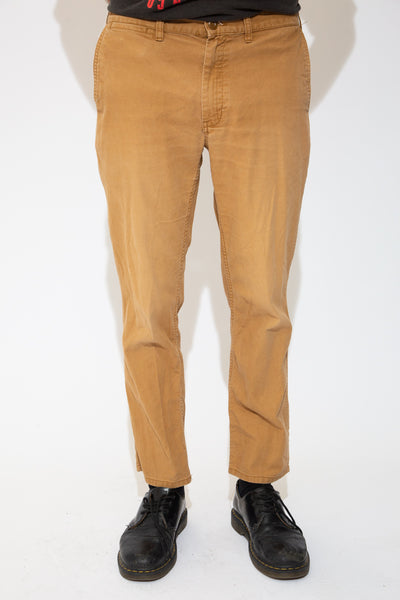 Light brown in colour, these pants have matching brown stitching, plenty of pockets, belt loops and Patagonia branding on the back/right pocket.