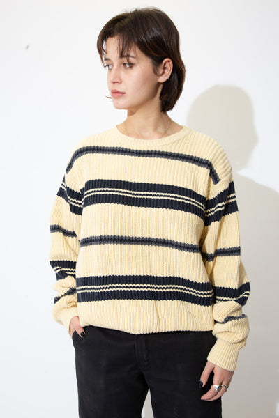 the model wears a cream and black striped knit