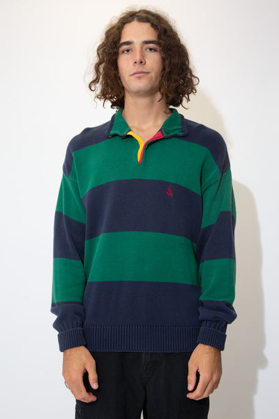 Thick knitted sweater striped in navy blue and green with a button up neckline and an embroidered red Nautica logo on the left chest.