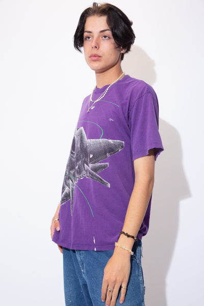 Purple in colour, this sick tee has a large fighter jet print on the front.