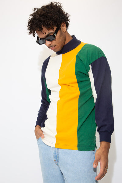 Vertically striped turtle neck sweater in white, navy blue, yellow and dark green.
